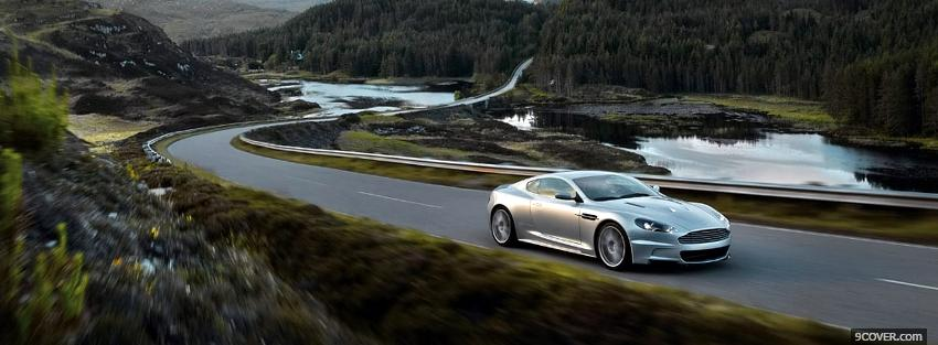 Photo aston martin on the road Facebook Cover for Free
