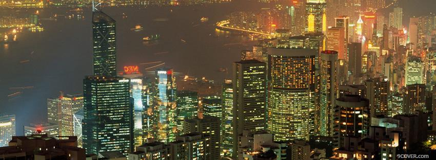 Photo the buildings in the city at night Facebook Cover for Free