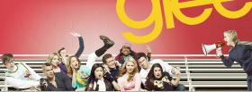 glee cast sitting on benches facebook cover
