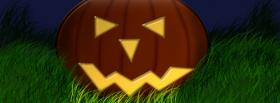 pumpkin in grass halloween facebook cover